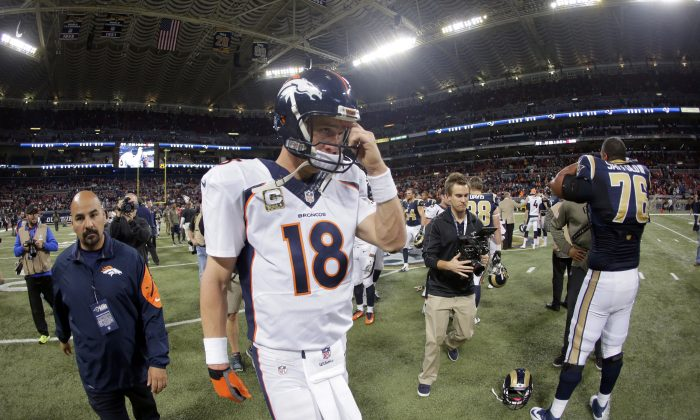 Denver Broncos quarterback Peyton Manning walks off the field following a 22-7 loss to the St. Louis Rams in an NFL football game Sunday, Nov. 16, 2014, in St. Louis. (AP Photo/Charlie Riedel)