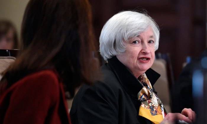 Federal Reserve Chairwoman Janet Yellen speaks during a meeting of the Board of Governors of the Federal Reserve System at the Federal Reserve in Washington on Oct. 22, 2014. The Federal Reserve releases minutes from its October interest-rate meeting on Wednesday, Nov. 19, 2014. (AP Photo/Susan Walsh)