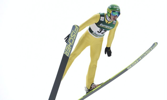 Finland's Ilkka Herola during the FIS World Cup Nordic Combined Ski Jumping HS130 competition in Lahti Ski Games in Lahti, Finland, on Feb. 28, 2014. (Heikki Saukkomaa/AFP/Getty Images)