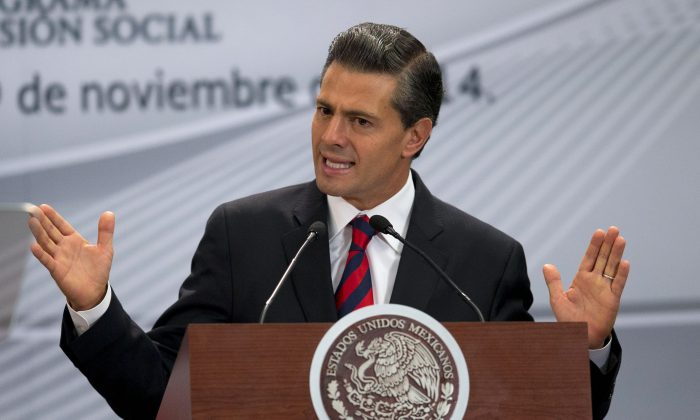 Mexican President Enrique Pena Nieto speaks during an event announcing World Bank support for Mexico's Prospera social net program at Los Pinos presidential residence in Mexico City on Nov. 19, 2014. (AP Photo/Rebecca Blackwell)