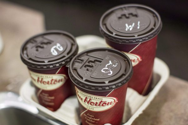Cups of coffee sit on a counter in a Tim Hortons in Oakville, Ontario. (The Canadian Press/Chris Young)
