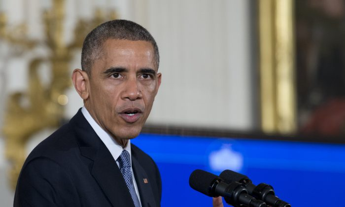 President Barack Obama speaks during the 'ConnectED to the Future' event in the East Room of the White House in Washington, Wednesday, Nov. 19, 2014. The conference is with superintendents and other educators from across the country who are leading their schools and districts in the transition to digital learning. (AP Photo/Carolyn Kaster)