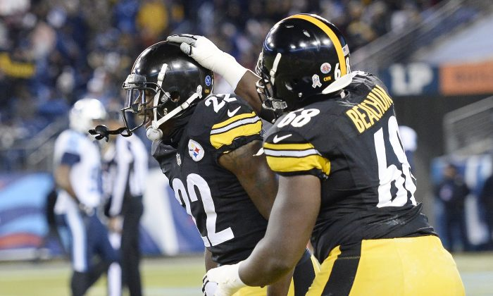 Pittsburgh Steelers cornerback William Gay (22) celebrates with Kelvin Beachum (68) after Gay scored a touchdown on a 28-yard interception return against the Tennessee Titans in the first half of an NFL football game Monday, Nov. 17, 2014, in Nashville, Tenn. (AP Photo/Mark Zaleski)