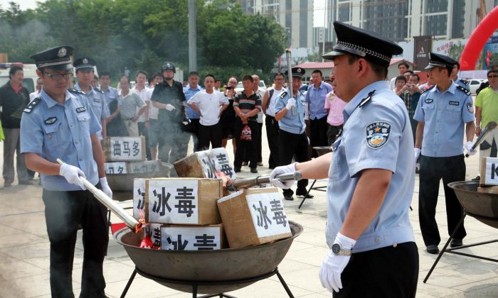 Policemen prepare to incinerate drugs on the International Day Against Drug Abuse and Illicit Trafficking on June 26, 2012 in Shenyang, China. Drug use in China has rapidly increased over the past two years, according to the Ministry of Public Security. (ChinaFotoPress/Getty Images)