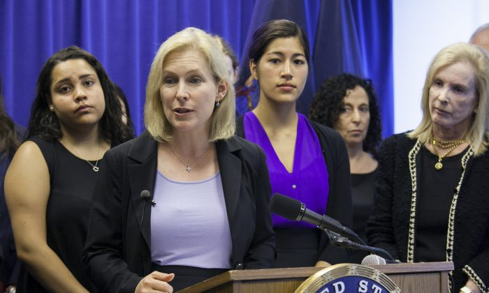 U.S. Sen. Kirsten Gillibrand and officials join student survivors in announcing support for a bipartisan effort in Congress to confront the scourge of sexual violence on college campuses. The announcement took place in New York on Aug. 13, 2014. (Samira Bouaou/Epoch Times)