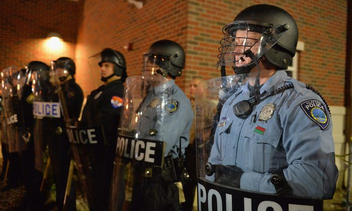 Police officers stand in riot gear during a protest on Nov. 19, 2014, outside the Ferguson Police Department in Ferguson, MO. (Michael B. Thomas/AFP/Getty Images)
