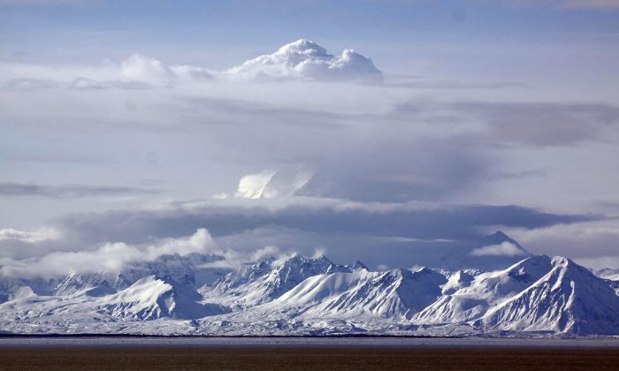 Mount Redoubt bellows steam as seen from Kenai, Alaska Thursday, March 26, 2009. The volcano on the west side of Cook Inlet erupted Thursday morning sending ash clouds an estimated 65,000 feet into the air and is expected to affect the towns of Kenai and Homer. (AP Photo/Al Grillo)