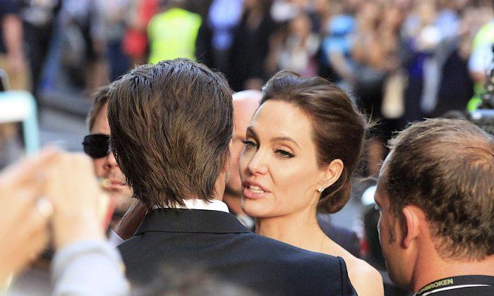 "Movie star Angelina Jolie producer, director of ""Unbroken"", speaks with Brad Pitt at the World Premiere in Sydney, Australia Monday Nov. 17, 2014. (AP Photo/Glenn Nicholls)"