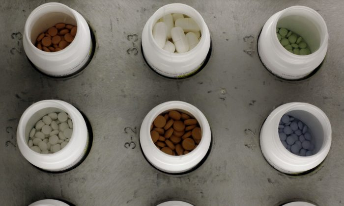 Various prescription drugs on the automated pharmacy assembly line at Medco Health Solutions, in Willingboro, N.J., on June 14, 2011. Some low-cost generic drugs that have helped restrain health care costs for decades are seeing unexpected price spikes of up to 8,000 percent, prompting a backlash from patients, pharmacists and now Washington lawmakers. (AP Photo/Matt Rourke)
