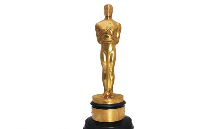 """Actor James Cagney's 1942 Oscar statuette for best actor, awarded for his performance as George M. Cohan in the film, """"Yankee Doodle Dandy."""" The auctioneer Nate D. Sanders will sell the Oscar statuette to the highest bidder on Nov. 20, 2014. (AP Photo/Nate D. Sanders Inc.)"""