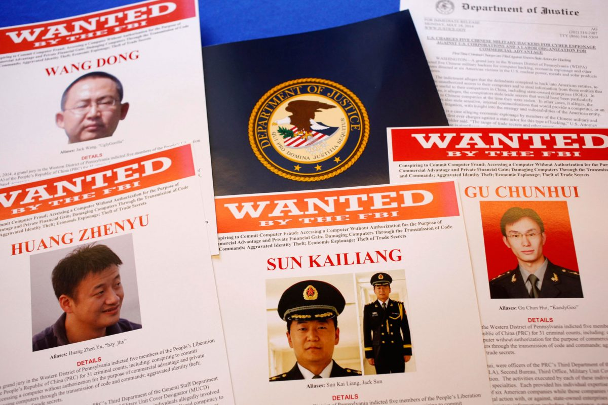 FBI material showing five Chinese military officers wanted on charges of economic espionage and trade secret theft are shown at the Justice Department in Washington on May 19, 2014. (Charles Dharapak/AP Photo)