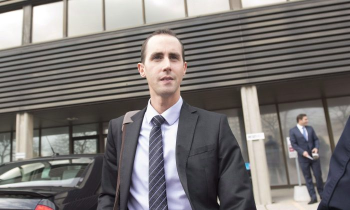 Former Conservative party staffer Michael Sona leaves court in Guelph on Oct. 17, 2014. Sona was sentenced on Nov. 19, 2014, to nine months in jail for his role in the successful plot to misdirect voters in the 2011 Robocalls scandal. (The Canadian Press/Hannah Yoon)