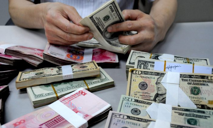 A staff member counts money at a branch of the Bank of China. (ChinaFotoPress/Getty Images)
