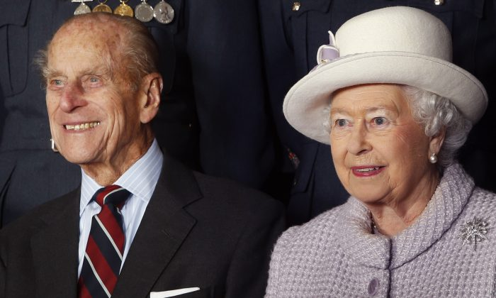 Prince Philip, Duke of Edinburgh and Queen Elizabeth II pose for a photo during a visit to RAF Lossiemouth on their 67th wedding anniversary on November 20, 2014 in Lossiemouth, Scotland. It was the Queen's first visit to the base since 2003. (Photo by Danny Lawson - WPA Pool/Getty Images)