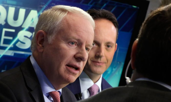 """Allergan CEO David Pyott (L) and Actavis CEO Brenton Saunders are interviewed on the floor of the New York Stock Exchange, on Nov. 17, 2014. Pyott is set to rake in an estimated $100 million in """"golden parachute"""" payments, according to a study done by pay-tracking firm Equilar at the request of The Associated Press. (AP Photo/Richard Drew)"""