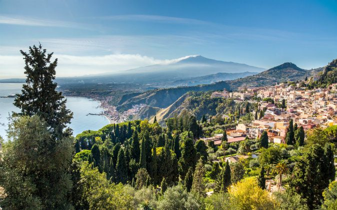 Taormina and the Etna via Shutterstock*