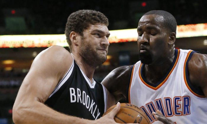 Brooklyn Nets' Brook Lopez, left, drives past Oklahoma City Thunder's Kendrick Perkins during the first quarter of an NBA basketball game in Oklahoma City, Friday, Nov. 21, 2014. (AP Photo/Sue Ogrocki)