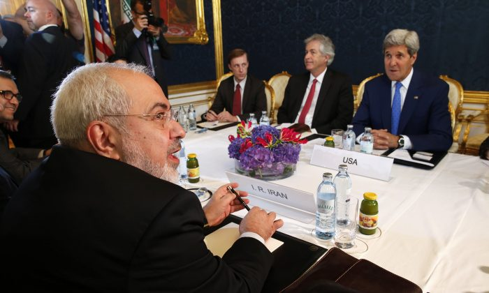 Iran's Foreign Minister Javad Zarif (L) holds a bilateral meeting with US Secretary of State John Kerry (R) on the second straight day of talks over Tehran's nuclear program in Vienna, on July 14, 2014. (Jim Bourg/AFP/Getty Images)
