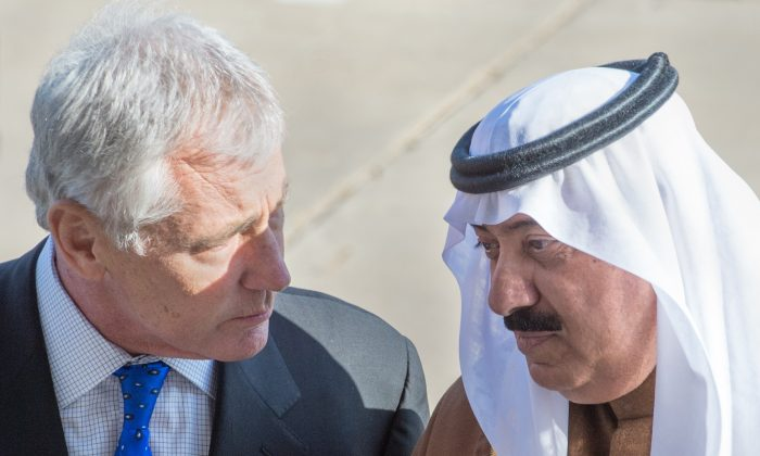 US Secretary of Defense Chuck Hagel (L) greets the Minister of the National Guard of Saudi Arabia, Prince Mitib bin Abdullah bin Abdul Aziz Al Saud(R), as he hosts an honor cordon at the steps of the Pentagon in Washington, DC, on Nov. 21, 2014. (Paul J. Richards/AFP/Getty Images)