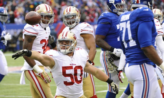 San Francisco 49ers inside linebacker Chris Borland (50) celebrates after intercepting a pass during the first half of an NFL football game against the New York Giants in East Rutherford, N.J., Nov. 16, 2014. (AP Photo/Bill Kostroun)
