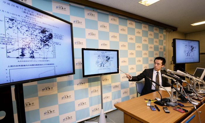 Japan Meteorological Agency official Yohei Hasegawa speaks about a strong earthquake that struck a mountainous area of central Japan Saturday night, at the agency in Tokyo, Sunday, Nov. 23, 2014. The magnitude-6.8 quake hit near Nagano city at 10:08 p.m. (13:08 GMT) at a depth of 10 kilometers (6 miles). No tsunami warning was issued. (AP Photo/Kyodo News)