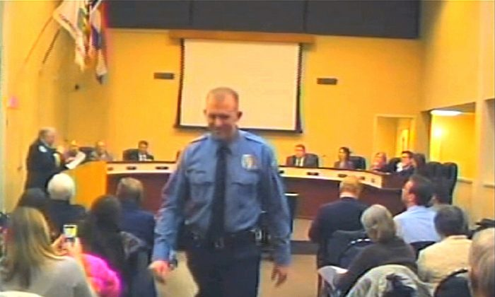 In this  Feb. 11, 2014 file image from video provided by the City of Ferguson, Mo., officer Darren Wilson attends a city council meeting in Ferguson. (AP Photo/City of Ferguson, File)