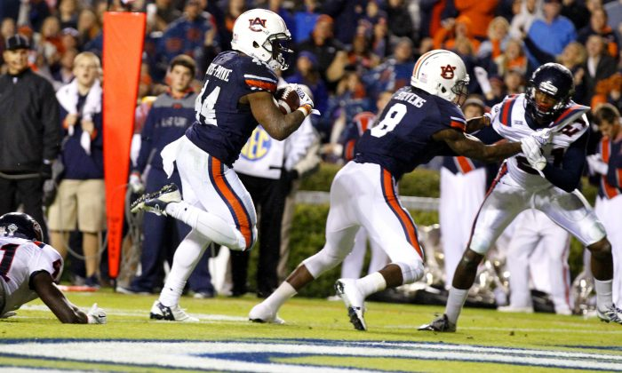 Auburn running back Cameron Artis-Payne (44) scores a touchdown during the first half of an NCAA college football game against Samford on Saturday, Nov. 22, 2014, in Auburn, Ala. (AP Photo/Butch Dill)
