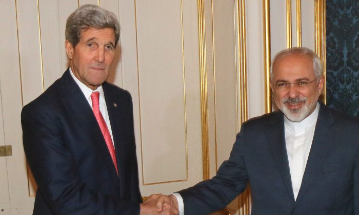 U.S. Secretary of State John Kerry shakes hands with Iranian Foreign Minister Mohammad Javad Zarif, right, prior to a bilateral meeting of the closed-door nuclear talks with Iran in Vienna, Austria, Sunday, Nov. 23, 2014. (AP Photo/Ronald Zak)