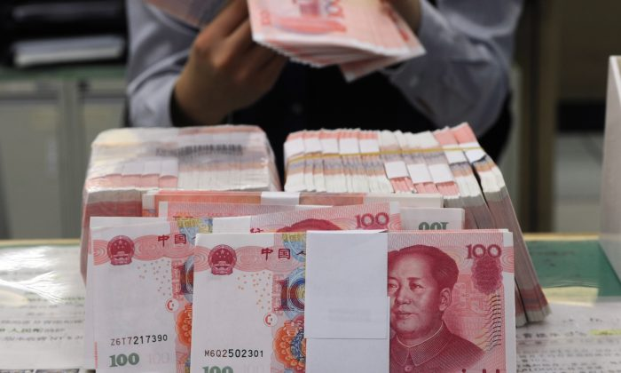 For decades, China's income tax laws have exacerbated the wealth gap  in China by discriminating against low-income groups (Sam Yeh/AFP/Getty Images)