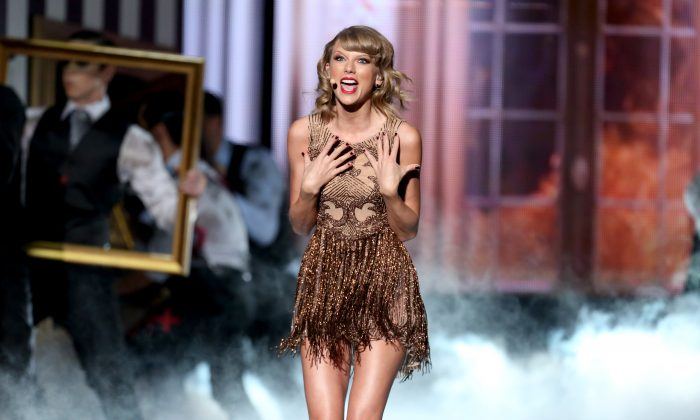 Taylor Swift performs on stage at the 42nd annual American Music Awards at Nokia Theatre L.A. Live on Sunday, Nov. 23, 2014, in Los Angeles. (Photo by Matt SaylesInvision/AP)
