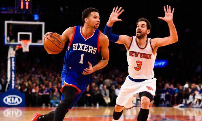 Michael Carter-Williams #1 of the Philadelphia 76ers attempts to drive past Jose Calderon #3 of the New York Knicks in the second quarter at Madison Square Garden on November 22, 2014 in New York City.  (Photo by Alex Goodlett/Getty Images)