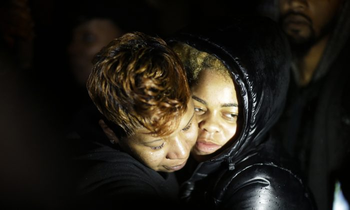 Lesley McSpadden (L), the mother of Michael Brown, embraces a supporter during a demonstration at the memorial near where the black teen was shot and killed by a white policeman more than three months ago, Saturday, Nov. 22, 2014, in Ferguson, Mo. (AP Photo/David Goldman)