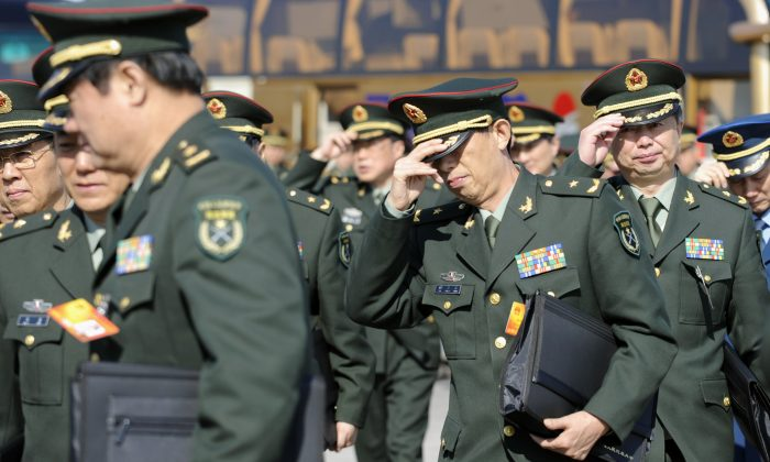 Chinese military delegates arrive for a plenary session of the National People's Congress in Beijing on March 9, 2010. (Liu Jin/AFP/Getty Images)