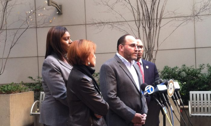 (L–R) Congress representative Nydia Valezquez, New York City public advocate Letitia James, president of Brooklyn's 75th precinct community council, John Rodriguez, and Congress representative Hakeem Jeffries, at a press conference in Brooklyn, N.Y., on Sunday, Nov. 23, 2014. Following the death of Akai Gurley after a police officer accidentally shot him inside a Brooklyn public housing project, officials called for changes to police department protocol. (Annie Wu/Epoch Times)