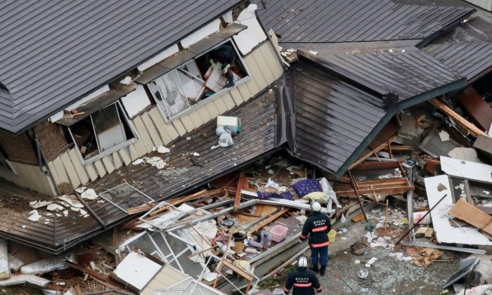 This aerial photo shows collapsed houses after a strong earthquake hit Hakuba, Nagano prefecture, central Japan, Sunday, Nov. 23, 2014. The magnitude-6.7 earthquake shook on Saturday night the mountainous area that hosted the 1998 Winter Olympics destroying more than half a dozen homes in the ski resort town. (AP Photo/Kyodo News)