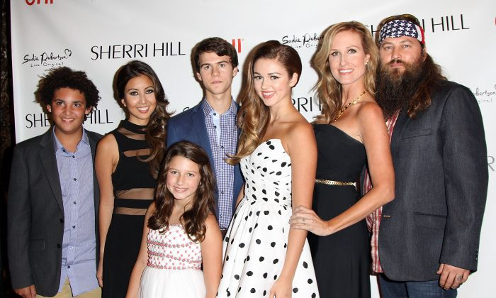 (L-R) Will Robertson, Rebecca Robertson, Bella Robertson, John Luke Robertson, Sadie Robertson, Korie Robertson and Willie Robertson attend an Evening By Sherri Hill fashion show during Mercedes-Benz Fashion Week Spring 2014 at Trump Tower on September 9, 2013 in New York City. (Photo by Monica Schipper/Getty Images)