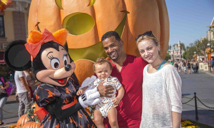 Minnie Mouse, actor Alfonso Ribeiro, Angela Unkrich Ribeiro and son, Alfonso Ribeiro, Jr. celebrate Halloween Time at Disneyland on September 30, 2014 in Anaheim, California. (Photo by Paul Hiffmeyer/Disney Parks via Getty Images)