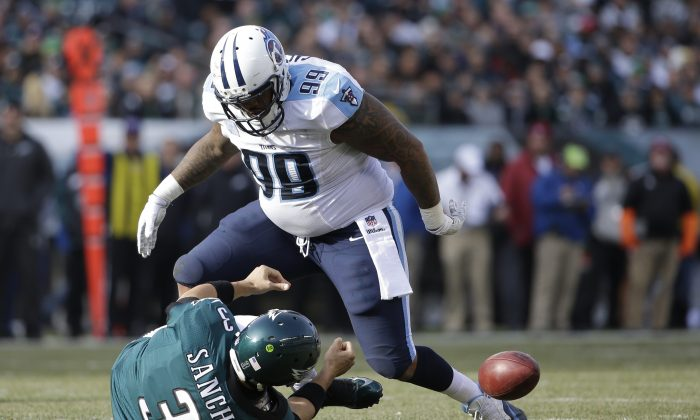 Tennessee Titans' Jurrell Casey (99) reacts after tackling Philadelphia Eagles' Mark Sanchez (3) during the first half of an NFL football game, Sunday, Nov. 23, 2014, in Philadelphia. (AP Photo/Matt Rourke)