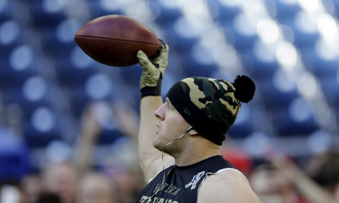 "JJ Watt, the Houston Texans star defensive end, was not ""caught with coke,"" meaning  cocaine, or drugs. In this Nov. 23, 2014, photo Houston Texans' J.J. Watt practices making one-handed catches before an NFL football game against the Cincinnati Bengals in Houston. The one-handed catch by New York Giants' Odell Beckham Jr. that became the most talked-about play from Sunday, Nov. 23, 2014,  did more than just boost his standing with the New York Giants, it paid off a routine growing popular among many skill players of practicing the impractical, one-handed circus grab.(AP Photo/David J. Phillip, File)"