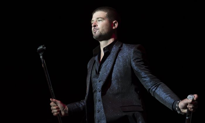 Robin Thicke performs on the Pepsi Max stage at Wireless festival in Finsbury Park, north London, Sunday, July 6, 2014. The first festival took place in June 2005 and was staged in Hyde Park. (Photo by Joel Ryan/Invision/AP)