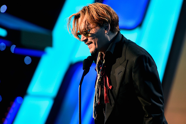 Johnny Depp speaks onstage during the 18th Annual Hollywood Film Awards at The Palladium on November 14, 2014 in Hollywood, California. (Photo by Frazer Harrison/Getty Images for DCP)