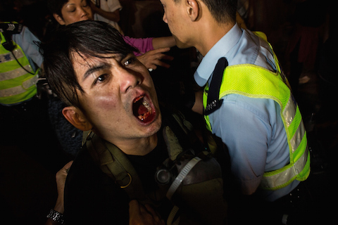 Riot police retain a man during clash with protesters at Mong Kok on November 25, 2014 in Hong Kong. The Mong Kok protest site is scheduled for clearance by baliffs this week after Hong Kong's high court authorized police to arrest protesters who obstruct bailiffs on the three interim restraining orders. (Lam Yik Fei/Getty Images)