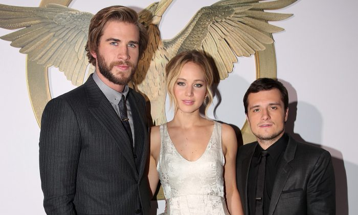 """Liam Hemsworth, from left, Jennifer Lawrence and Josh Hutcherson arrive at the Los Angeles premiere of """"The Hunger Games: Mockingjay - Part 1"""" at the Nokia Theatre on Monday, Nov. 17, 2014. (Photo by Matt Sayles/Invision/AP)"""