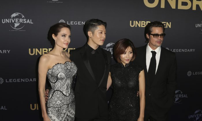 "Movie star Angelina Jolie left, director of ""Unbroken"", poses for photos with Mayavi, second left, Melody Ishihara, center, and Brad Pitt, right, at the World Premiere of the film in Sydney, Australia Monday Nov. 17, 2014. (AP Photo/Glenn Nicholls)"