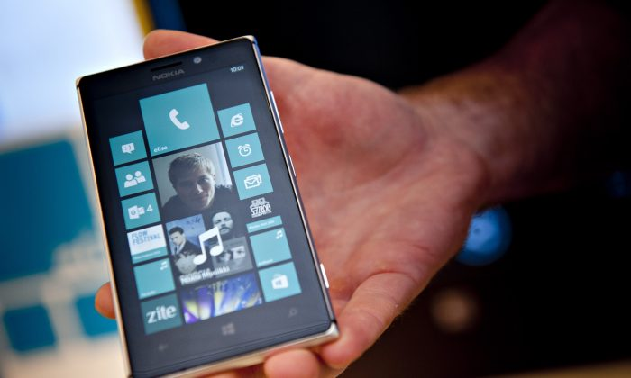 A photo taken on Aug. 15, 2013 shows a Nokia Lumia 925 mobile telephone at the flagship store of Finnish mobile phone manufacturer Nokia in Helsinki. (Mikko Stig/AFP/Getty Images)