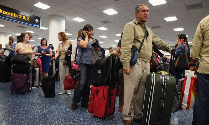 Passengers wait in line for a flight at Miami International Airport on April 16, 2013. (Joe Raedle/Getty Images)