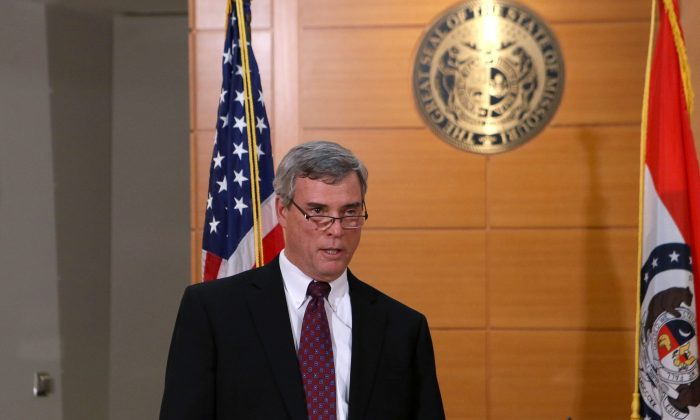 St. Louis County Prosecutor Robert McCulloch announces the grand jury's decision not to indict Ferguson police officer Darren Wilson in the Aug. 9 shooting of Michael Brown, an unarmed black 18-year old,  on Monday, Nov. 24, 2014, at the Buzz Westfall Justice Center in Clayton, Mo. (AP Photo/St. Louis Post-Dispatch, Cristina Fletes-Boutte)