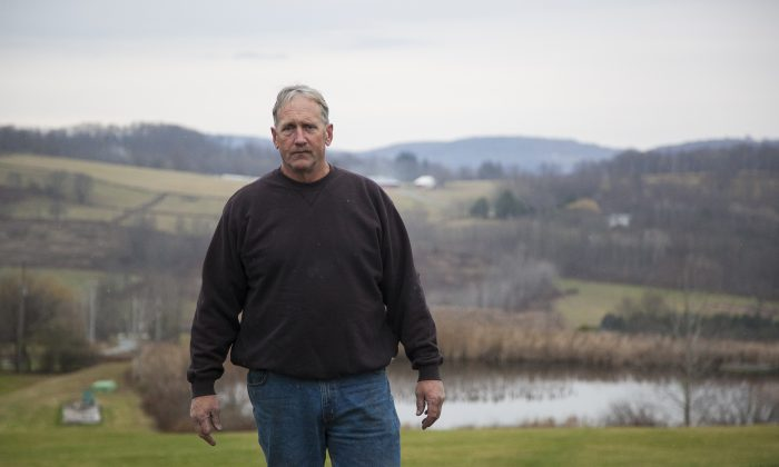 Bill Graby, a dairy farmer, on his land in Sullivan County, N.Y., on Nov. 13, 2014. Graby was forced to file bankruptcy and may lose his over 100-year-old family farm if Gov. Andrew Cuomo continues to stall in making a decision on the fracking moratorium in New York. (Samira Bouaou/Epoch Times)
