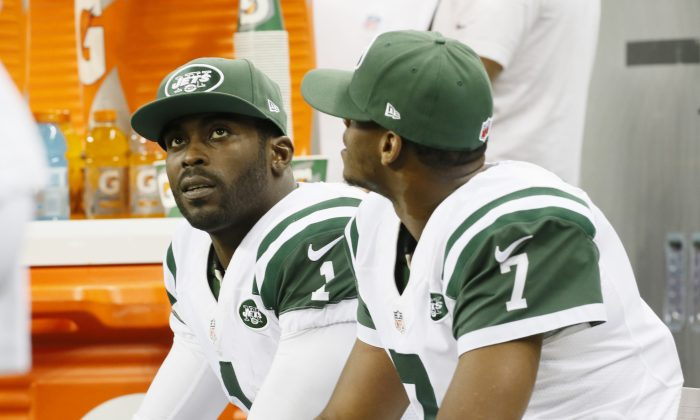 Michael Vick in a file photo along with Geno Smith (AP Photo/Paul Sancya)