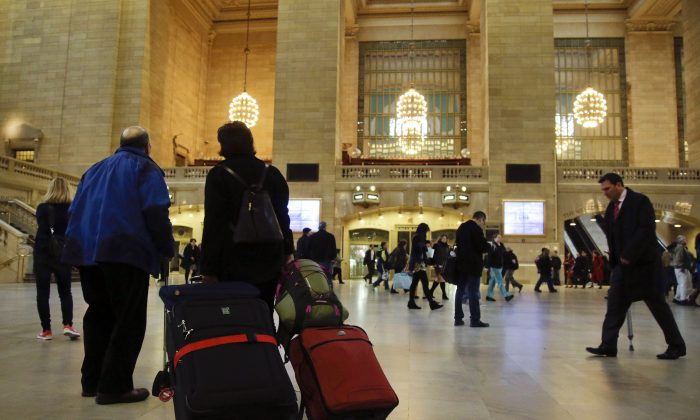 Here's a list of what's open and closed, and the hours for retailers like Walmart, Target, Best Buy, and Costco on Thanksgiving. John Eresian, left, of Exeter, N.H. and his daughter from San Francisco make their way through Grand Central Terminal to catch a train to Connecticut for the Thanksgiving holiday, Tuesday, Nov. 25, 2014, in New York. Some Thanksgiving travelers along the East Coast were heading out early because of a forecast calling for a nor'easter that will bring rain and snow. (AP Photo/Julie Jacobson)